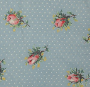 Pink rosebuds on blue with white dot pattern