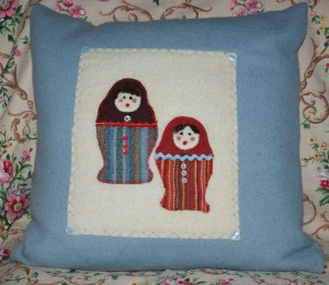 Matryoshka Doll cushion on cornflower blue cushion