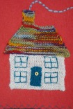 Detail of knitted home - on a cushion