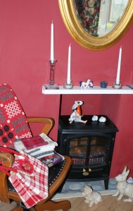 A woollen tapestry blanket, bag and remnants in the study