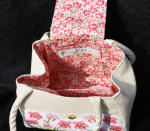 'Carnation' inside the handbag