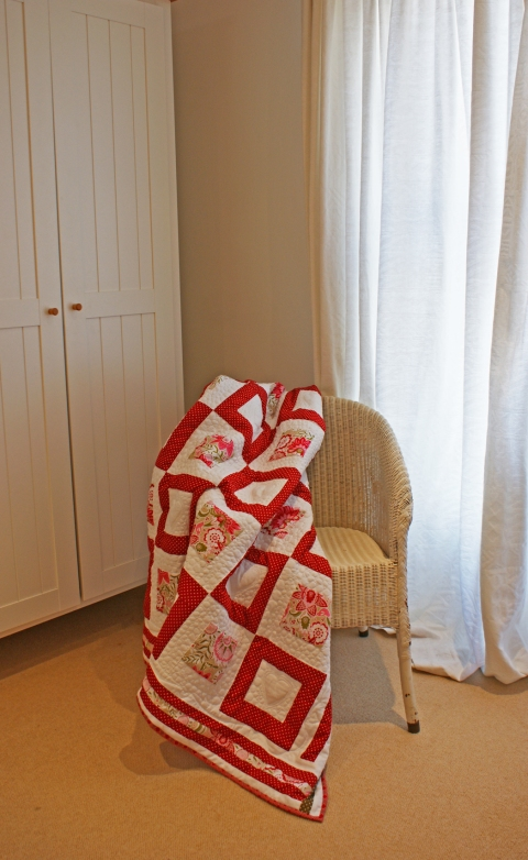 Lloyd Loom chair & quilt