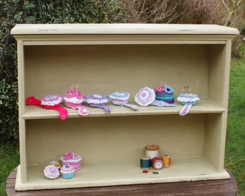 Shelves full of pincushions