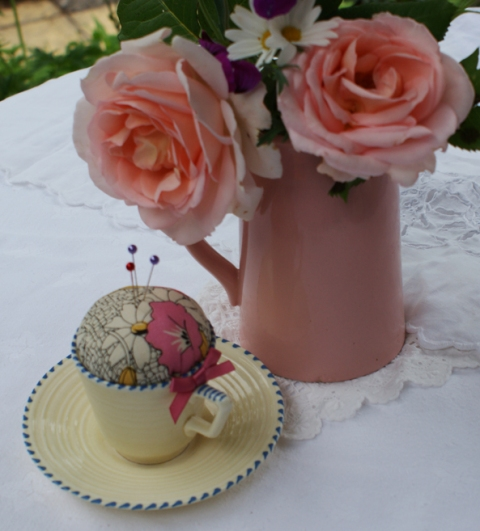 art deco pincushion in a coffee cup