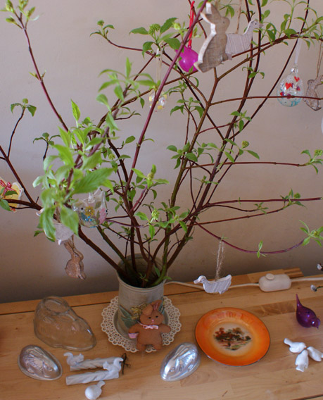 my easter twig tree has sprouted leaves and blossom