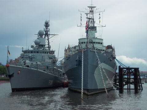 HMS Belfast (right) with a visiting German boat alongside