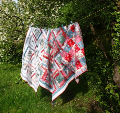 quilts in the sunshine, under the apple trees