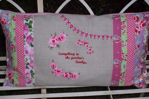 roses and bunting - perfect for a pretty seat under the apple trees