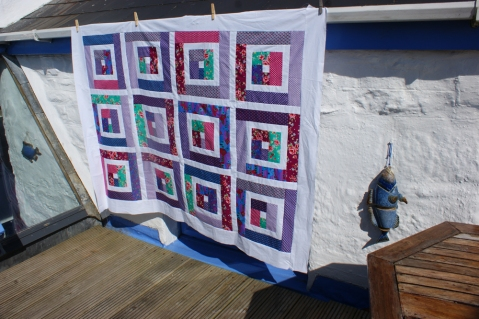 I felt inspired by the colourful little cottage and created Hot Town patchwork