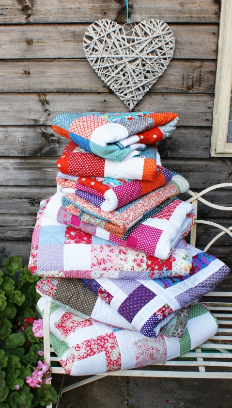 Nine quilts completed in July