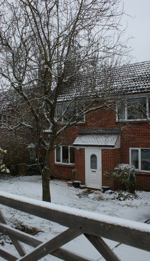 snowy front of house