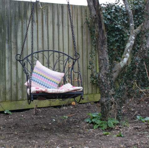 hanging seat in the apple tree