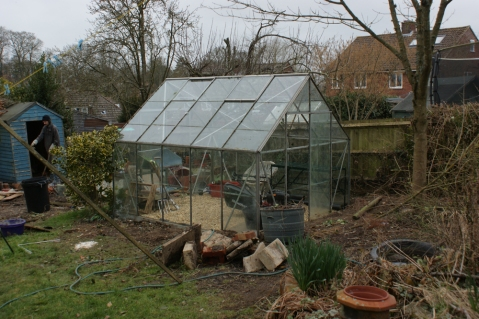ivy gone, panes replaced and a new base laid