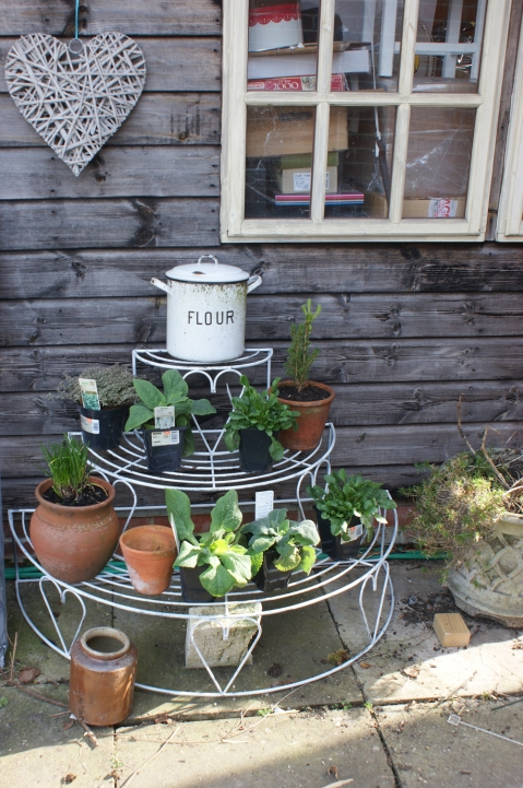 lovely vintage plant stand - I have plans for trailing geraniums and petunias