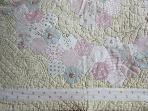 antique quilt with more recent patchwork added to cover the damage