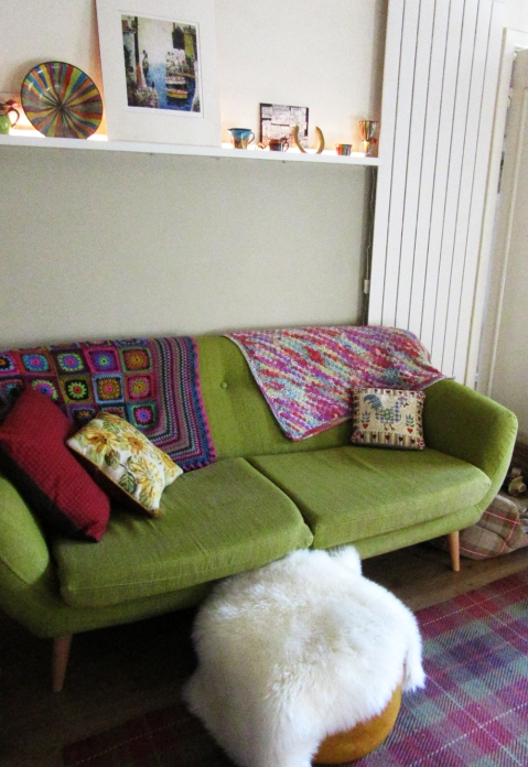 on my sofa with Gypsy Rose Afghan